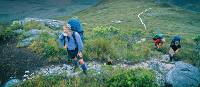 Hiker stops to rest on the South Coast Track | Don Fuchs