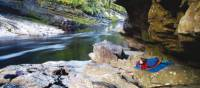 Camping under a rock shelter at Newland's Cascade on the Franklin River | Carl Roe